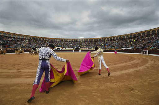 Spanish bullfighters and assistants warm up before a bullfight in the southwestern Spanish town of Olivenza, Spain, on Sunday, March 3, 2013. Bullfighting is an ancient tradition in Spain and the season runs from March to October.&#40;AP Photo&#47;Daniel Ochoa de Olza&#41; <span class=meta>(AP Photo&#47; Daniel Ochoa de Olza)</span>