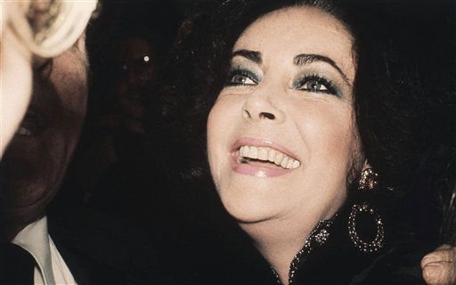Elizabeth Taylor Burton is pictured leaving her mid-Manhattan hotel en route to see her husband Richard Burton in his opening night performance in ?Equus? on Broadway, Feb. 17, 1976 in New York. Burton replaced Tony Perkins in the role of the psychiatrist in the play. &#40;AP Photo&#47;Ron Frehm&#41; <span class=meta>(AP Photo&#47; Ron Frehm)</span>
