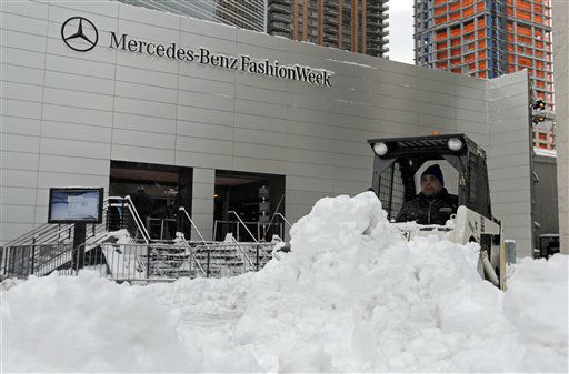 A worker plows snow from the plaza of Lincoln Center, home of New York&#39;s Fashion Week shows, Saturday, Feb. 9, 2013. In New York City, the snow total in Central Park was 8.1 inches by 3 a.m. &#40;AP Photo&#47;Richard Drew&#41; <span class=meta>(AP Photo&#47; Richard Drew)</span>