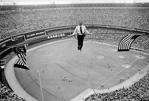 Karl Wallenda, 71, walks on a cable 200 feet above the playing field at Veterans Stadium between doubleheader baseball games in Philadelphia, Pa., Monday, May 31, 1976.  Wallenda unfurled a bicentennial and American flag from his balancing bar after doing a headstand midway across the 640-foot span steel cable.  The walk took 18 minutes.   &#40;AP Photo&#47;Bill Ingraham&#41; <span class=meta>(AP Photo&#47; BILL INGRAHAM)</span>