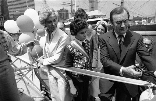 Gov. Hugh Carey, right, cuts ribbon at New York South Street Seaport Museum, Thursday, June 3, 1976 during ceremonies launching New York State?s official bicentennial barge. Helping Carey are, Joan K. Davidson, Chairman of the State?s council on the arts, left, and Brooklyn student Peter Gozzi, 11, center, who won a statewide contest by naming the barge the ?New York Festival Barge.? The barge will make a 36-stop four-and-one half month voyage through the state with historical exhibits. &#40;AP Photo&#41; <span class=meta>(AP Photo&#47; Anonymous)</span>