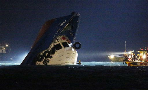 "<div class=""meta ""><span class=""caption-text "">Rescuers check on a half submerged boat after it collided Monday night near Lamma Island, off the southwestern coast of Hong Kong Island Tuesday, Oct. 2, 2012. Authorities in Hong Kong have rescued 101 people after a ferry collided with a tugboat and sank. A local broadcaster says eight people died. (AP Photo/Kin Cheung) (AP Photo/ Kin Cheung)</span></div>"