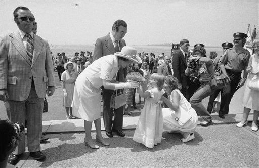 Julia Beame, four-year-old grand daughter of New York&#39;s Mayor Abraham Beame presents England&#39;s Queen Elizabeth II with a bouquet on her majesty&#39;s arrival at Battery Park in Manhattan on Friday, July 9, 1976 in New York, woman at right is unidentified.   New York Gov. Hugh Carey stands behind the queen.   &#40;AP Photo&#41; <span class=meta>(AP Photo&#47; Anonymous)</span>