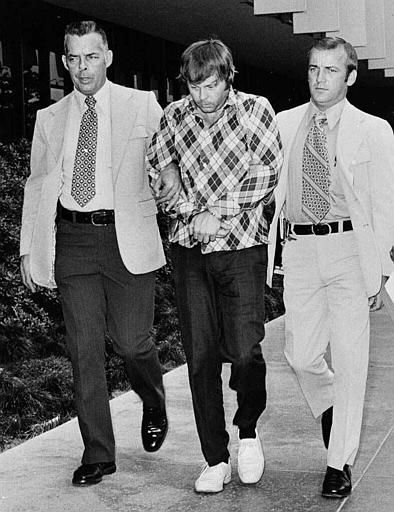 Edward C. Allaway, center, alleged killer of seven persons at California State University two days earlier, is led into Orange County courthouse July 14,1976. Allaway, was arraigned on seven counts of murder and held without bail. The prosecution asked for a death penalty under a California provision covering mass murders. Officer escorts are not identified. &#40;AP Photo&#41; <span class=meta>(AP Photo&#47; TMS)</span>