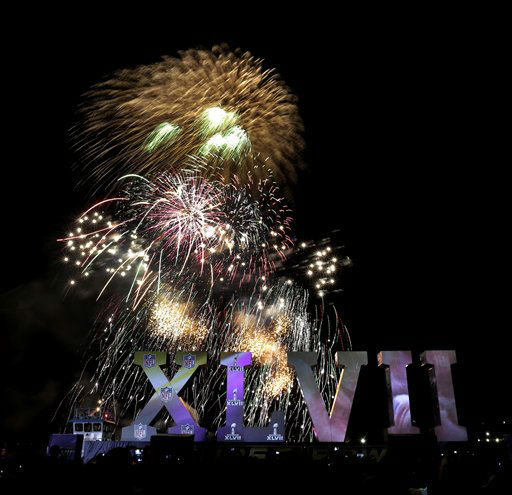 Fireworks explode as the Roman numerals for the NFL Super Bowl XLVII float on the Mississippi River Thursday, Jan. 31, 2013, in New Orleans. The city will host the football game between the San Francisco 49ers and Baltimore Ravens. &#40;AP Photo&#47;Charlie Riedel&#41; <span class=meta>(AP Photo&#47; Charlie Riedel)</span>