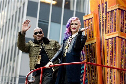 Flo Rida and Stayc Reigns ride a float in the Macy&#39;s Thanksgiving Day Parade in New York, Thursday, Nov. 22, 2012. The American harvest holiday came as portions of the Northeast were still coping with the wake of Superstorm Sandy, and volunteers planned to serve thousands of turkey dinners to people it left homeless or struggling. &#40;AP Photo&#47;Charles Sykes&#41; <span class=meta>(AP Photo&#47; Charles Sykes)</span>