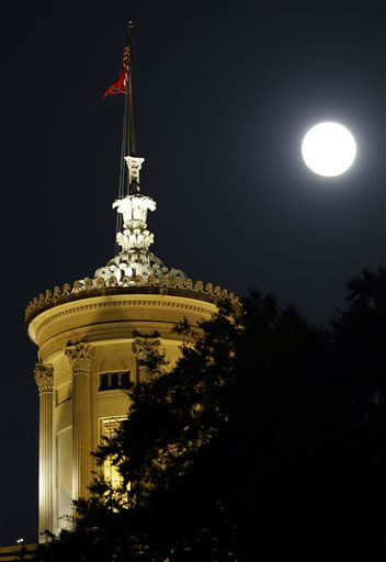 The moon rises behind the Tennessee state capitol on Saturday, June 22, 2013, in Nashville, Tenn. The biggest and brightest full moon of the year, called a supermoon, happens as the moon passes closer to earth than usual. &#40;AP Photo&#47;Mark Humphrey&#41; <span class=meta>(AP Photo&#47; Mark Humphrey)</span>