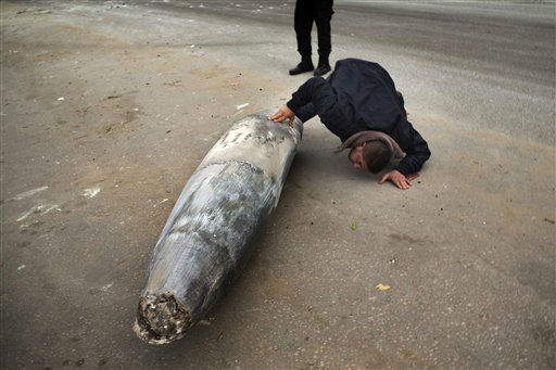 "<div class=""meta ""><span class=""caption-text "">A Hamas officer inspects an unexploded Israeli missile in Gaza City, Saturday, Nov. 17, 2012. Israel bombarded the Hamas-ruled Gaza Strip with more than 180 airstrikes early Saturday, the military said, widening a blistering assault on militant operations to include the prime minister's headquarters, a police compound and a vast network of smuggling tunnels. The new attacks followed an unprecedented rocket strike aimed at the contested holy city of Jerusalem that raised the stakes in Israel's violent confrontation with Palestinian militants. (AP Photo/Bernat Armangue) (AP Photo/ Bernat Armangue)</span></div>"