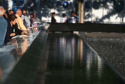 Pilsoon Kang, who lost her son, Joon Koo Kang who worked at World Trade Center, touches the memorial during commemoration ceremony of the 11th anniversary of the Sept. 11, 2001 terrorist attacks by the North Pool at World Trade Center in New York on Tuesday, Sept. 11, 2012. &#40;AP Photo&#47;The New York Times, Chang W. Lee, Pool&#41; <span class=meta>(AP Photo&#47; Chang W. Lee)</span>