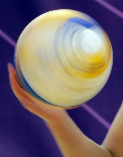 April Ross of the United States spins the ball during a beach volleyball match against Spain at the 2012 Summer Olympics, Thursday, Aug. 2, 2012, in London. &#40;AP Photo&#47;Dave Martin&#41; <span class=meta>(AP Photo&#47; Dave Martin)</span>