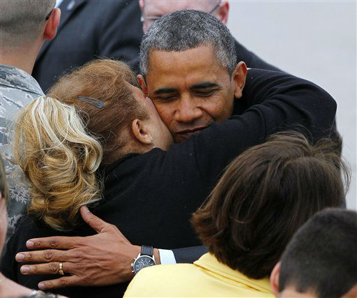 President Barack Obama hugs a guest on the tarmac after stepping off Air Force One at McGuire Air Force Base, N.J. Tuesday, May 28, 2013. The president and  New Jersey Gov. Chris Christie will tour New Jersey shore communities devastated by Super Storm Sandy. &#40;AP Photo&#47;Rich Schultz&#41; <span class=meta>(AP Photo&#47; Rich Schultz)</span>
