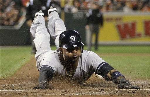 "<div class=""meta ""><span class=""caption-text "">New York Yankees' Eduardo Nunez scores a run on a single by Ichiro Suzuki, of Japan, in the ninth inning of Game 1 of the American League division baseball series against Baltimore Orioles on Sunday, Oct. 7, 2012, in Baltimore. New York won 7-2. (AP Photo/Patrick Semansky) (AP Photo/ Patrick Semansky)</span></div>"