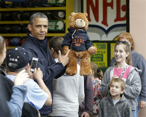 President Barack Obama holds up a stuffed bear that New Jersey Gov. Chris Christie, not shown, had won tossing a football after playing the &#39;Touchdown Fever&#39; game on the boardwalk during their visit to Point Pleasant, NJ., Tuesday, May 28, 2013.  Obama traveled to New Jersey to join Christie to inspect and tour the Jersey Shore&#39;s recovery efforts from Hurricane Sandy. &#40;AP Photo&#47;Pablo Martinez Monsivais&#41; <span class=meta>(AP Photo&#47; Pablo Martinez Monsivais)</span>