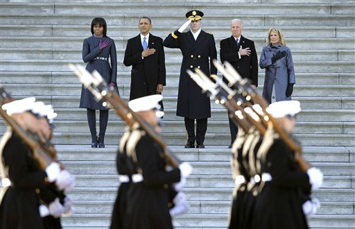 President Barack Obama, first lady Michele Obama, left, Army Major General Michael Linnington, Joint Forces Headquarters, National Capitol Region, center, and Vice President Joe Biden and his wife Jill Biden, place their hands over their hearts as they review the troops following his ceremonial swearing-in during the 57th Presidential Inauguration at the U.S. Capitol in Washington, Monday, Jan. 21, 2013. &#40;AP Photo&#47;Cliff Owen&#41; <span class=meta>(AP Photo&#47; Cliff Owen)</span>