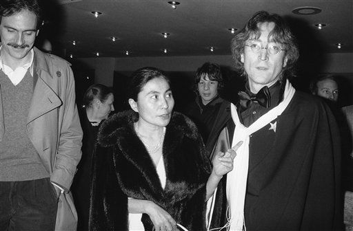 Yoko Ono gestures in evening on Tuesday, Jan. 18, 1977 as she and husband John Lennon, the former Beatle, arrive at New York&#39;s Minskoff Theater.     They were attending the premiere performance of their Merce Cunningham Dance Company. &#40;AP Photo&#41; <span class=meta>(AP Photo&#47; R4  K. PEC)</span>