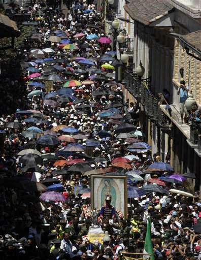 People walk in procession with an image of the Virgin of Guadalupe in Quito, Ecuador, Monday, Sept. 24, 2012. The image is a copy of original in Mexico, a gift from Mexico&#39;s Curia to Ecuador, where the majority are Catholics. &#40;AP Photo&#47;Dolores Ochoa&#41; <span class=meta>(AP Photo&#47; Dolores Ochoa)</span>
