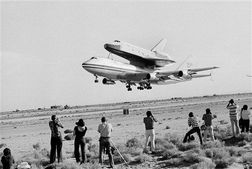 America&#39;s space shuttle Enterprise rides atop the 747 carrier as she takes off from Edwards Air Force Base, Calif., Aug. 12, 1977. The shuttle is to be blasted away from the 747 for her first free flight. &#40;AP Photo&#41; <span class=meta>(AP Photo&#47; Anonymous)</span>