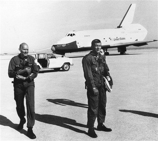 In this photo provided by NASA, astronauts Gordon Fullerton, left, and Fred Haise are shown in foreground following the free flight of the space shuttle Enterprise, at Edwards Air Force base, Calif., Aug. 12, 1977. &#40;AP Photo&#47;NASA&#41; <span class=meta>(AP Photo&#47; Anonymous)</span>