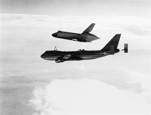 "<div class=""meta ""><span class=""caption-text "">The space shuttle Orbiter Enterprise ?earns its wings"", as it clears its 747 carrier aircraft on August 12, 1977 to begin the first free flight of the Spacecraft. Astronauts Fred Haise and Gordon Fullerton piloted the Enterprise during its Maiden Flight. (AP Photo) (AP Photo/ S, RO  XCJ)</span></div>"