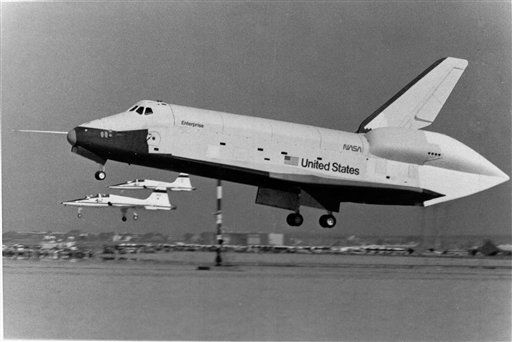 In this photo provided by NASA, the 75-ton space shuttle Enterprise makes a perfect landing at Edwards Air Force base, Calif., Aug. 13, 1977 as it completed its first free-flight test. Someday it will carry astronauts and scientists to space and bring them back to a wheels-down landing. Two chase-planes carrying observers land in background. &#40;AP Photo&#47;NASA&#41; <span class=meta>(AP Photo&#47; Anonymous)</span>
