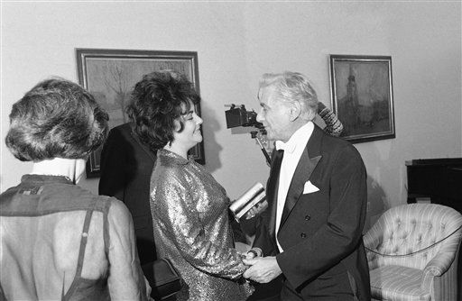 Actress Elizabeth Taylor chats with conductor Leonard Bernstein backstage at the Kennedy Center in Washington at night on Tuesday, Oct. 12, 1977.    Bernstein performed with the National Symphony Orchestra at the center. &#40;AP Photo&#47;Charles Bennett&#41; <span class=meta>(AP Photo&#47; Charles Bennett)</span>