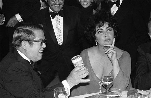 Elizabeth Taylor had this reaction when Billy Carter, the President?s brother, offered her a can of ?Billy? brand beer. Carter was among many celebrities attending ?An All-Star Tribute to Elizabeth Taylor? party at night on Sunday, Nov. 14, 1977 at the Burbank Studios. The show will be presented on Thursday, December 1 on the CBS Television Network. &#40;AP Photo&#47; Wally Fong&#41; <span class=meta>(AP Photo&#47; Wally Fong)</span>