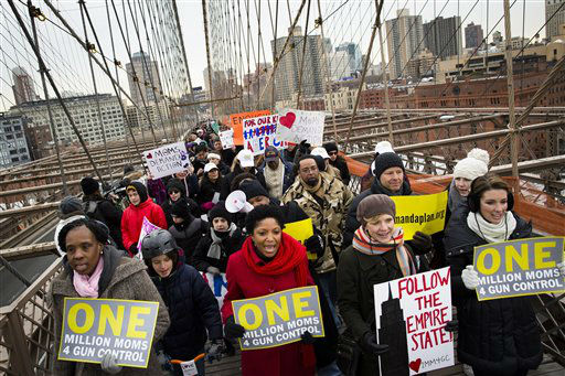 Demonstrators march over the Brooklyn bridge towards downtown Manhattan during the One Million Moms for Gun Control Rally, Jan. 21, 2012, in New York. Demonstrators called for new gun control legislation, demanding a ban on assault weapons and stricter regulations on gun purchases. The One Million Moms for Gun Control group formed in the wake of last month&#39;s massacre at a Connecticut elementary school. &#40;AP Photo&#47;John Minchillo&#41; <span class=meta>(AP Photo&#47; John Minchillo)</span>