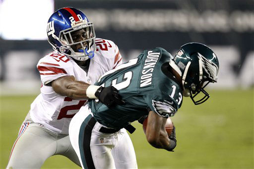 New York Giants defensive back Prince Amukamara &#40;20&#41; tries to tackle Philadelphia Eagles wide receiver Damaris Johnson &#40;13&#41; during the first half of an NFL football game Sunday, Sept. 30, 2012, in Philadelphia. &#40;AP Photo&#47;Mel Evans&#41; <span class=meta>(AP Photo&#47; Mel Evans)</span>