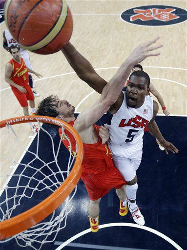 United States&#39; Kevin Durant &#40;5&#41; slam dunks to score over Spain&#39;s Pau Gasol, left, during the men&#39;s gold medal basketball game at the 2012 Summer Olympics, Sunday, Aug. 12, 2012, in London. &#40;AP Photo&#47;Eric Gay, pool&#41; <span class=meta>(AP Photo&#47; Eric Gay)</span>