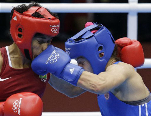 "<div class=""meta ""><span class=""caption-text "">Brazil's Adriana Araujo, left, fights Russia's Sofya Ochigava during their lightweight 60-kg semifinal boxing match at the 2012 Summer Olympics, Wednesday, Aug. 8, 2012, in London.(AP Photo/Patrick Semansky) (AP Photo/ Patrick Semansky)</span></div>"