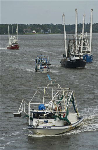 Shrimp boats make their way to the Back Bay in Biloxi, Miss., on Monday, Aug. 27, 2012, in anticipation of the arrival of Tropical Storm Isaac. The storm is expected to make landfall somewhere on the Mississippi or Louisiana coast sometime Tuesday night or early Wednesday morning. &#40;AP Photo&#47;Drew Tarter&#41; <span class=meta>(AP Photo&#47; Drew Tarter)</span>