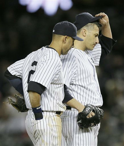 New York Yankees&#39; Andy Pettitte tips is cap as teammate Derek Jeter joins him on the mound in the seventh inning during Game 1 of the American League championship series against the Detroit Tigers Saturday, Oct. 13, 2012, in New York. &#40;AP Photo&#47;Matt Slocum&#41; <span class=meta>(AP Photo&#47; Matt Slocum)</span>