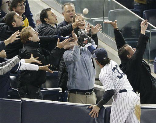 New York Yankees&#39; Nick Swisher reaches into the stands for a foul ball hit by Baltimore Orioles&#39; J.J. Hardy in the 11th inning of Game 3 of the American League division baseball series on Wednesday, Oct. 10, 2012, in New York. Swisher was unable to make the catch. &#40;AP Photo&#47;Peter Morgan&#41; <span class=meta>(AP Photo&#47; Peter Morgan)</span>