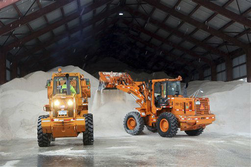 Sanitation workers use tractors to pile up salt at a depot, Friday, Feb. 8, 2013 in New York. A storm poised to dump up to 3-feet of snow from New York City to Boston and beyond beginning Friday could be one for the record books, forecasters warned, as residents scurried to stock up on food and water and road crews readied salt and sand. &#40;AP Photo&#47;Mary Altaffer&#41; <span class=meta>(Photo&#47;Mary Altaffer)</span>