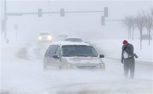 A man waits for help after becoming stuck in snow along West 6th Street in Lawrence, Kan., Sunday, March 24, 2013. Few signs of spring are being found in parts of the Midwest as a snowstorm brings heavy snow and high winds. &#40;AP Photo&#47;Orlin Wagner&#41; <span class=meta>(AP Photo&#47; Orlin Wagner)</span>