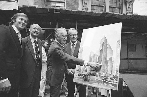 Governor Hugh Carey points to an artists&#39; conception of the new New York Hyatt Hotel&#47;Convention facility that will be build on the site of the former Commordore Hotel, June 28, 1978.  At the launching ceremony are, from left:  Donald Trump, son of the city developer Fred C. Trump; Mayor Ed Koch of New York; Carey; and Robert T. Dormer, executive vice president of the Urban Development Corp.  &#40;AP Photo&#41; <span class=meta>(AP Photo&#47; XMB)</span>