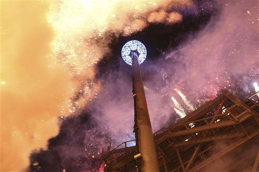 "<div class=""meta ""><span class=""caption-text "">The fireworks explode as the Waterford crystal ball is raised at the beginning of Times Square New Year's celebration, Monday, Dec. 31, 2012 in New York. (AP Photo/Mary Altaffer) (AP Photo/ Mary Altaffer)</span></div>"