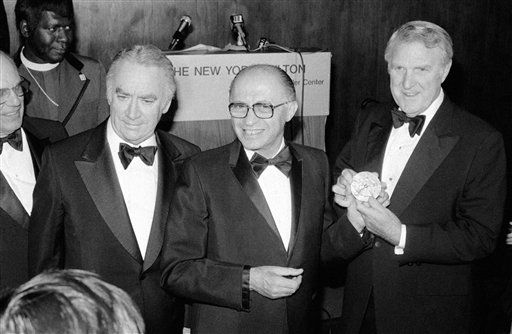 Israeli Prime Minister Menachem Begin, center, receives the Family of Man Award with gold medallion inscribed ?In recognition of creative leadership and dedicated service? from Raymond P. Shafer, right, president of the Society for the Family of Man, as New York Gov. Hugh Carey, left, looks on at awards dinner at the Hilton Hotel in New York on Nov. 2, 1978. &#40;AP Photo&#47;Richard Drew&#41; <span class=meta>(Photo&#47;Richard Drew)</span>