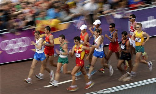 Athletes compete in the men&#39;s 20-kilometer race walk near Buckingham Palace during the 2012 Summer Olympics  Saturday, Aug. 4, 2012, in London. &#40;AP Photo&#47;Charlie Riedel&#41; <span class=meta>(AP Photo&#47; Charlie Riedel)</span>