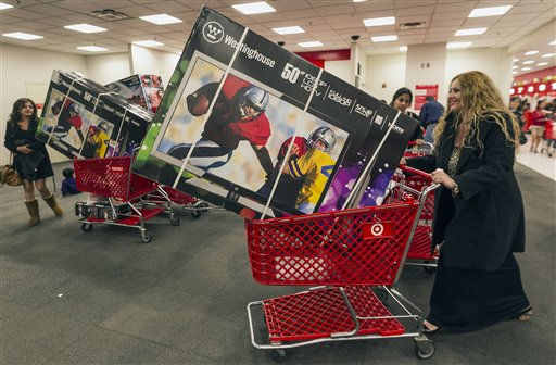 Shopper Lisa Camberos, right, gets a television doorbuster deal at the Target store in Burbank, Calif., on Thursday, Nov. 22, 2012. While stores typically open in the wee hours of the morning on the day after Thanksgiving known as Black Friday, openings have crept earlier and earlier over the past few years. Now, stores from Wal-Mart to Toys R Us are opening their doors on Thanksgiving evening, hoping Americans will be willing to shop soon after they finish their pumpkin pie. &#40;AP Photo&#47;Damian Dovarganes&#41; <span class=meta>(AP Photo&#47; Damian Dovarganes)</span>