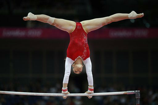 French gymnast Youna Dufournet performs on the uneven bars during the artistic gymnastics women&#39;s qualifications at the 2012 Summer Olympics, Sunday, July 29, 2012, in London. &#40;AP Photo&#47;Matt Dunham&#41; <span class=meta>(AP Photo&#47; Matt Dunham)</span>