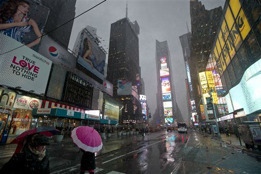 Pedestrians walk through Times Square as snow falls Friday, Feb. 8, 2013, in New York. A blizzard of potentially historic proportions threatens to strike the Northeast with 1 to 2 feet of snow forecast along the densely populated Interstate 95 corridor from New York City to Boston and beyond. &#40;AP Photo&#47;Frank Franklin II&#41; <span class=meta>(AP Photo&#47; Frank Franklin II)</span>