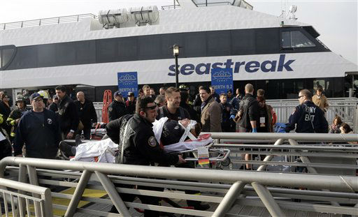 "<div class=""meta ""><span class=""caption-text "">New York City firefighters remove an injured passenger of the Seastreak Wall Street ferry, in New York,  Wednesday, Jan. 9, 2013. The ferry from Atlantic Highlands, N.J., banged into the mooring as it arrived at South Street in lower Manhattan during morning rush hour, injuring as many as 50 people, at least one critically, officials said.(AP Photo/Richard Drew) (AP Photo/ Richard Drew)</span></div>"