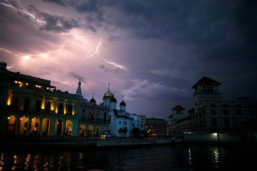 "<div class=""meta image-caption""><div class=""origin-logo origin-image ""><span></span></div><span class=""caption-text"">A lightning illuminates the sky over the Malecon during a lightning storm in Havana, Cuba, Wednesday, Sept 19, 2012. (AP Photo/Ramon Espinosa) (AP Photo/ Ramon Espinosa)</span></div>"