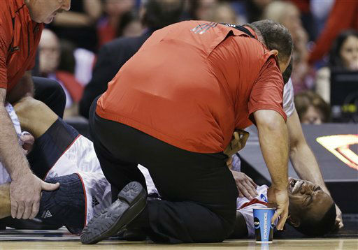 "<div class=""meta ""><span class=""caption-text "">Louisville guard Kevin Ware (5) reacts as trainers look at his injury during the first half of the Midwest Regional final against Duke in the NCAA college basketball tournament, Sunday, March 31, 2013, in Indianapolis. (AP Photo/Darron Cummings) (AP Photo/ Darron Cummings)</span></div>"