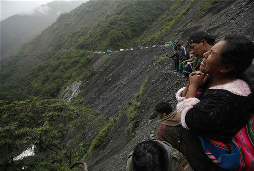 "<div class=""meta ""><span class=""caption-text "">A woman mourns as rescue workers search for victims after a bus crash on the outskirts of Pijchu, Bolivia, Monday, Jan. 21, 2013. According to police, at least ten people were killed and several injured after a bus drove off a mountain road and plunged down a ravine early Monday (AP Photo/Juan Karita) (AP Photo/ Juan Karita)</span></div>"