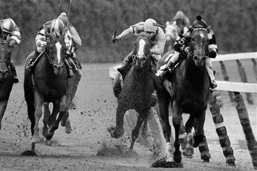 FILE - In this June 9, 1979, file photo, Coastal and jockey Ruben Hernandez, second from right, make the move to pass Spectacular Bid &#40;5&#41; and jockey Ron Franklin on the final turn during the Belmont Stakes horse race at Belmont Park in Elmont, N.Y. Spectacular Bid stepped on a safety pin in his stall the morning of the race and would later fade in the stretch under Franklin to finish in third. As I&#39;ll Have Another prepares to attempt to win the Belmont Stakes in his quest to become the 12th Triple Crown champion and first in 34 years on Saturday, June 9, 2012, The Associated Press takes a look at some of the 19 horses who won the Kentucky Derby and the Preakness, but came up short in the final leg of the Triple Crown, and how the race unfolded. &#40;AP Photo&#47;Ron Frehm, File&#41; <span class=meta>(AP Photo&#47; Ron Frehm)</span>