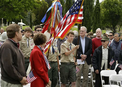 "<div class=""meta ""><span class=""caption-text "">Boy Scouts present the colors during a Memorial Day service at the Mountain View cemetery Monday, May 27, 2013, in Oakland, Calif. (AP Photo/Ben Margot) (AP Photo/ Ben Margot)</span></div>"