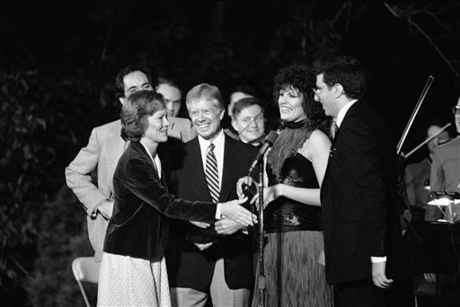 First lady Rosalynn Carter reaches to shake hands with composer Marvin Hamlisch, right, after he and entertainers Luci Arnaz and Robert Klein completed a show at a dinner held on the South Lawn of the White House in Washington on Sept. 23, 1979, for members of Congress. From left: Roalynn Carter; President Jimmy Carter; Arnaz, Hamlisch; and Robert Klein, standing behind Mrs. Carter. &#40;AP Photo&#47;Mark Wilson&#41; <span class=meta>(AP Photo&#47; Mark Wilson)</span>