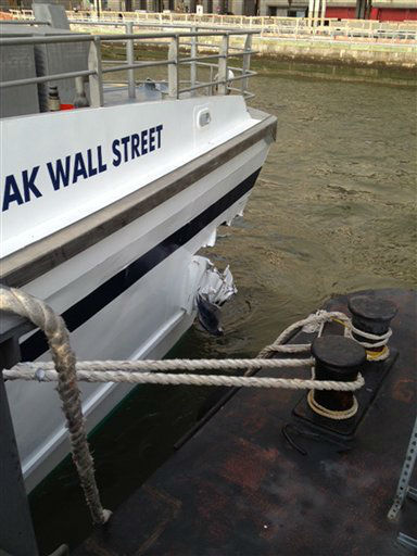"<div class=""meta ""><span class=""caption-text "">A hole is torn near the bow of the Seastreak Wall Street ferry after it banged into the mooring as it arrived at a pier in New York's financial district Wednesday, Jan. 9, 2013. Police and fire officials say 30 to 50 people were injured when the ferry struck a dock during the morning rush hour. (AP Photo/Larry Neumeister) (AP Photo/ Larry Neumeister)</span></div>"